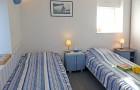 Chambre 2 lits au RDC du gîte L'Ecurie