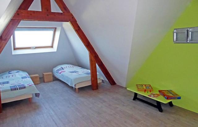 Chambre avec 2 lits simples et 2 lits en mezzanine