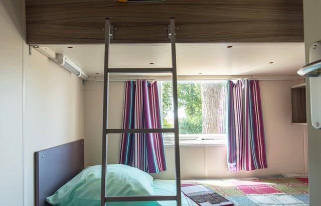 Chambre avec 2 lits simples superposés